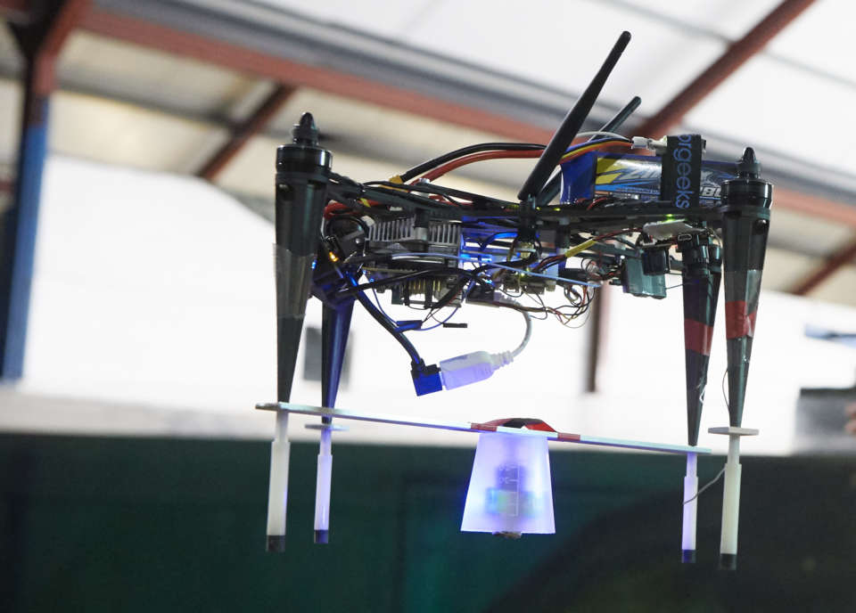 Drone carrying sensor.